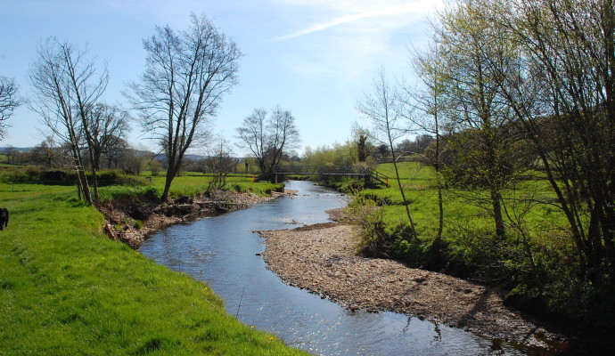 Photo of a stream through fields on the East Devon Way