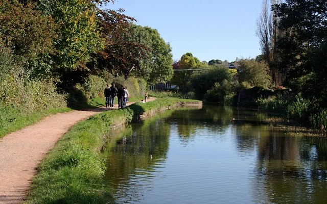 Photo of the Grand Western Canal with walkers on the tow path