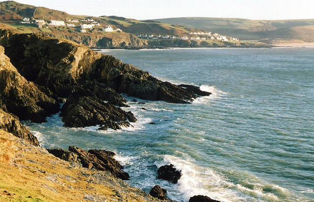 Photo looking along the coast past rocky cliffs to Mortehoe and Woolacombe from Morte Point