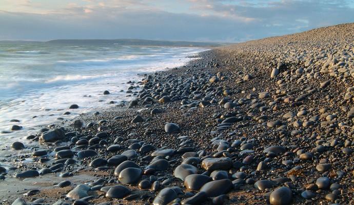 Photo of the shoreline on a pebble beach