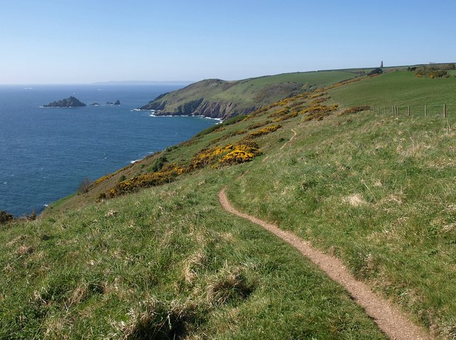 Photo along the South Devon coast showing fields, coastal cliffs and sea with the Daymark in the distance