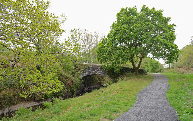 Photo of a tow path and canal with bridge