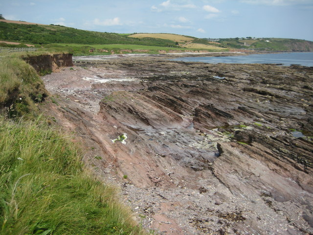 View across a rocky shore to Wembury beach