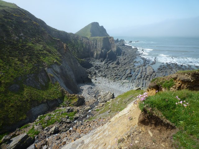 Photo of sea, rocky coast and north Devon coastal cliffs at Hartland Point