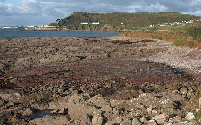 Photo of a rocky shore and the south Devon coastline at Andurn Point near Plymouth