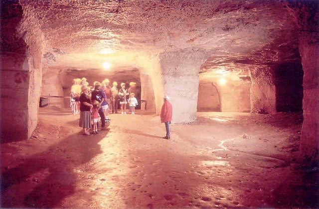 Photo of a group of people inside Beer Quarry caves