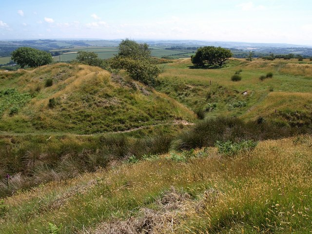 Landscape photos looking across grassy mounds of the iron age hillfort Blackdown Rings