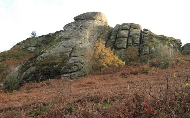 Photo looking up at the granite rocks off Blackingtone Rock on Dartmoor