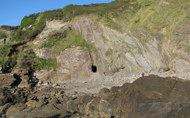 Photo of a rocky beach with cliffs at Combe Martin
