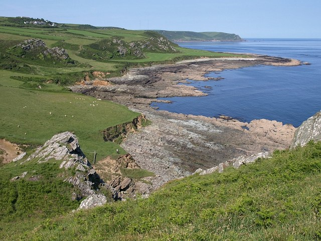 Landscape photo of Prawle Point showing coastal fields and rocky shore