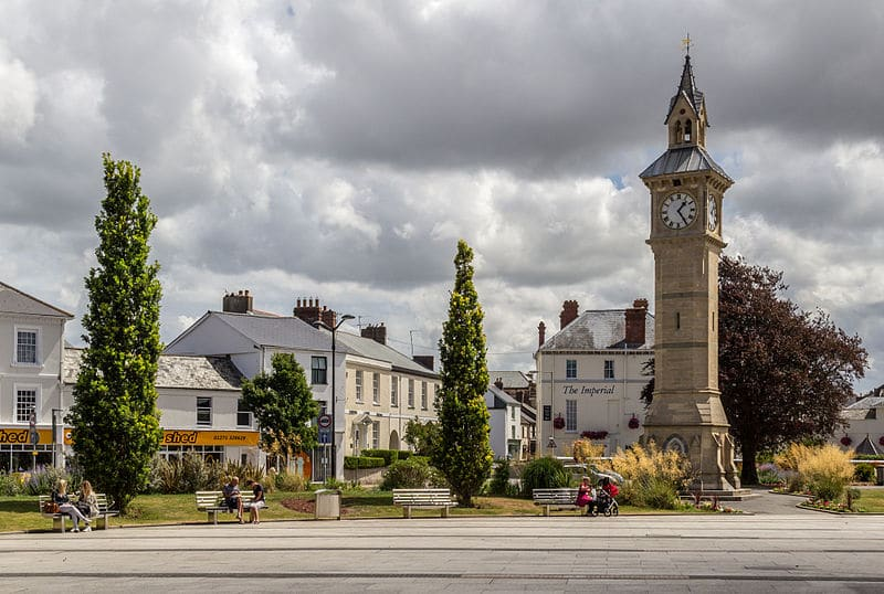 Photo of a clock tower at Barnstaple with the town behind