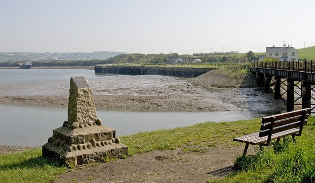 Photo of a view across the estuary and mud to Fremington Quay with a bridge on the right