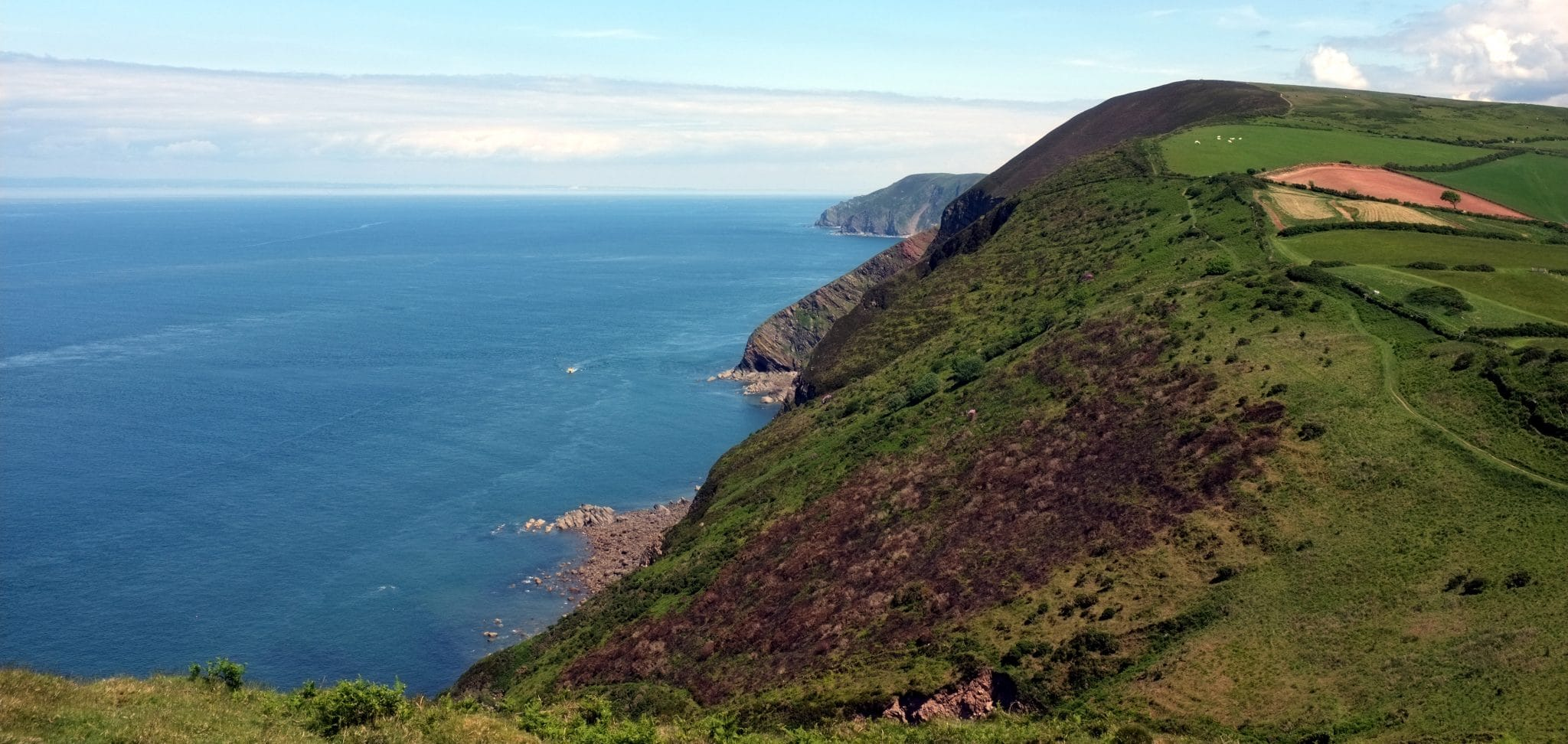 Photo showing the north Devon coastal cliffs above the sea at Great Hangman