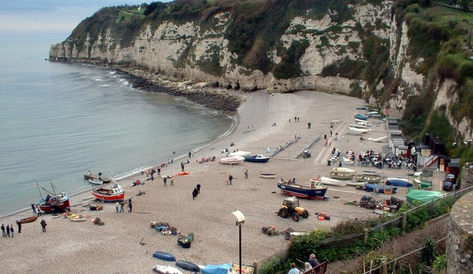 Photo looking down on the pebble beach at Beer with chalk cliffs in the background