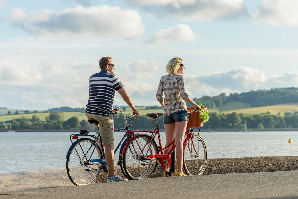 Photo of cyclists on the Tarka Trail alongside the estuary near Instow
