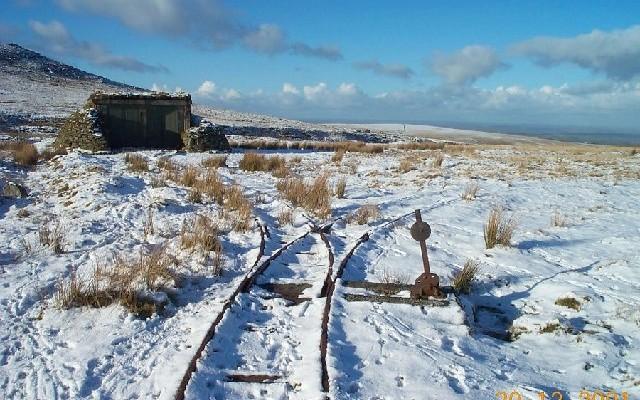 Photo of rail tracks on moorland in the snow near Okehampton Camp