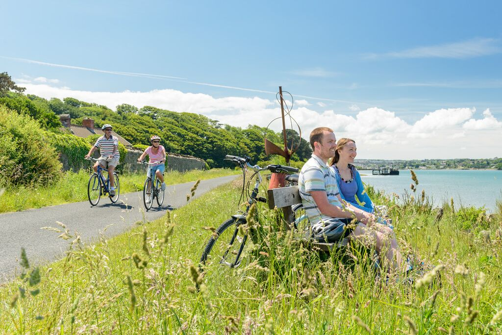 Photo of cyclists on the Tarka Trail alongside the estuary at Instow