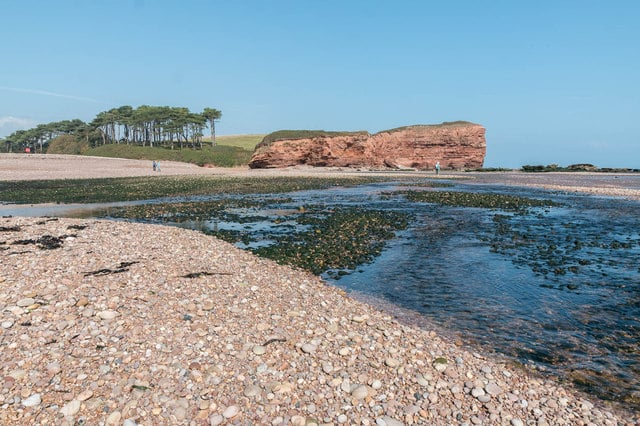 Photo of the otter estuary where it meets the pebble beach at Budleigh