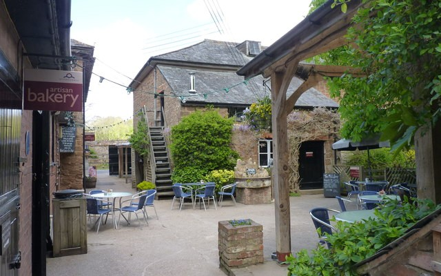 Photo of a courtyard between old mill buildings at Otterton Mill