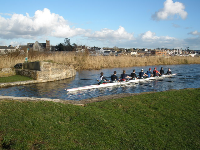 Photo of rowers on the Exeter Ship Canal with views of the city in the background