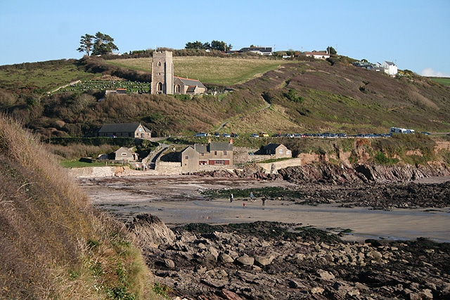 Photo across the beach at Wembury with Wembury Church in the background
