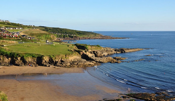 Photo looking across the beach at Bovisand from the coast path