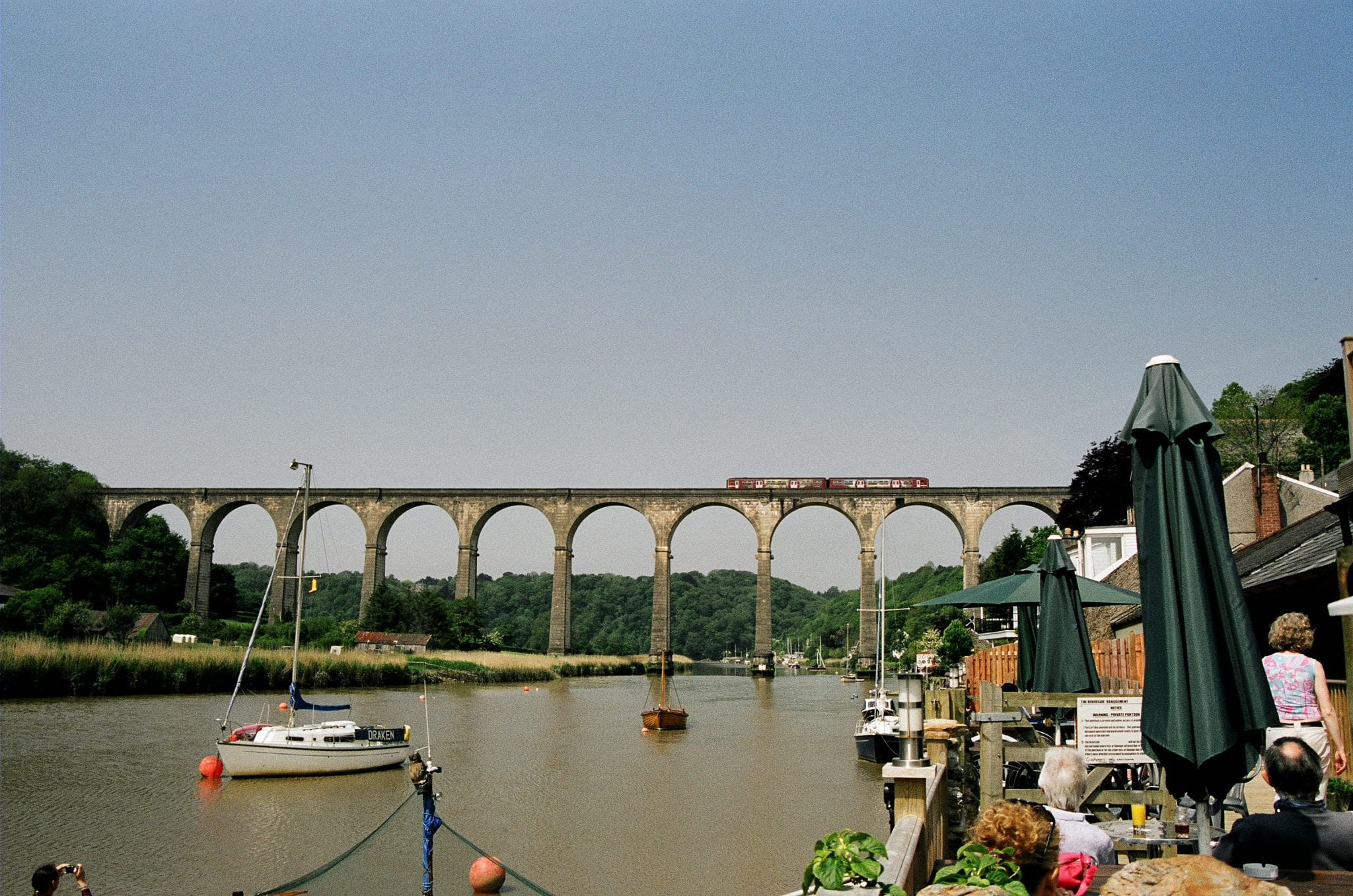 Photo of the Tamara River at Calstock with the Calstock viaduct in the background