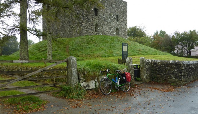Photo of a bicycle by the gate in front of Lydford Castle