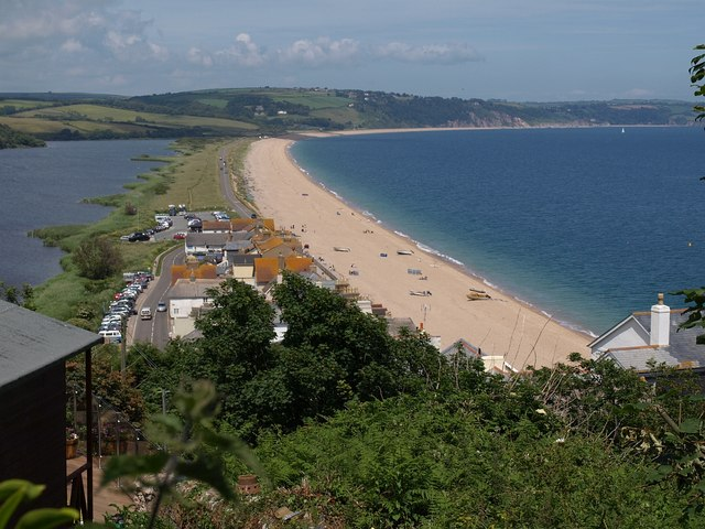 Landscape photo looking along the length of the beach and road at Slapton Ley with lagoon on the left and sea on the right