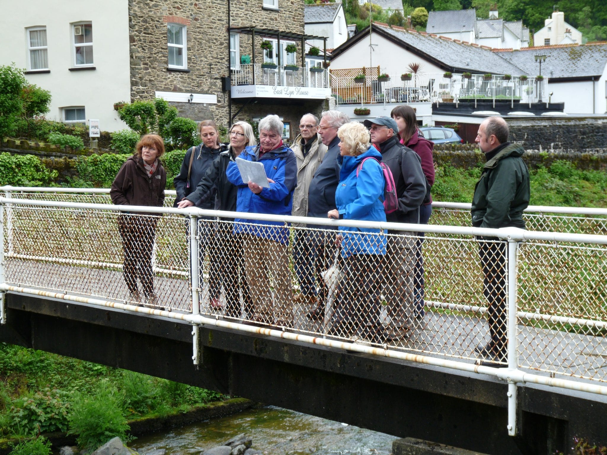 Photo of walkers on a bridge as part of a Naturally Healthy Walk