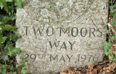 Photo of the Two Moors Way waymarking stone at Stowford Bridge