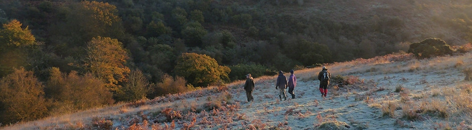 Photo of walkers on a hillside on Exmoor on a frosty Autumn morning