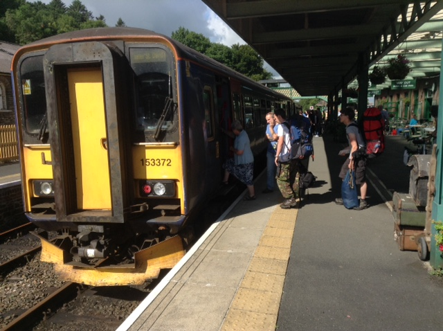 Photo of passengers barding the Sunday Rover train from the station platform
